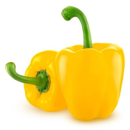 two fresh yellow bell peppers on a white background.