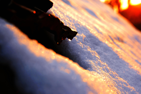 Sunset over the snow, and the snow is melting