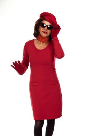 Fashionable senior woman. Wearing sunglasses. Isolated. photo