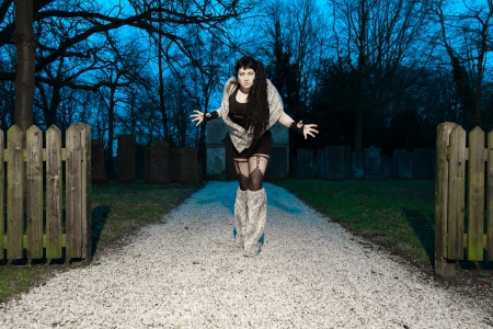 Gothic girl on cemetery  photo