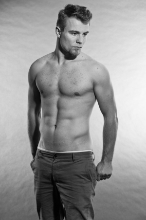 naked male body: Muscled fitness man. Black and white studio shot. Stock Photo