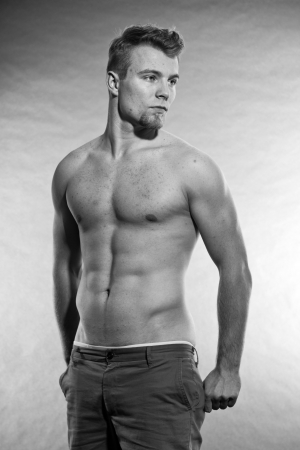 nude fashion model: Muscled fitness man. Black and white studio shot. Stock Photo