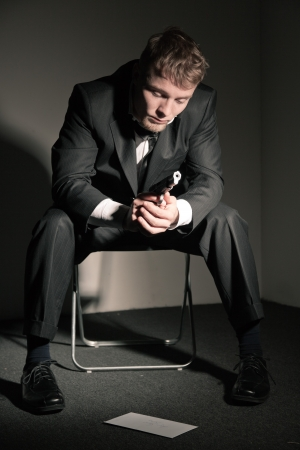Suicidal business man in empty office. photo