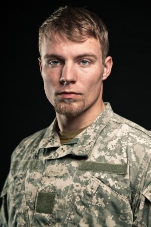 fatigues: Military young man. Studio portrait. Stock Photo