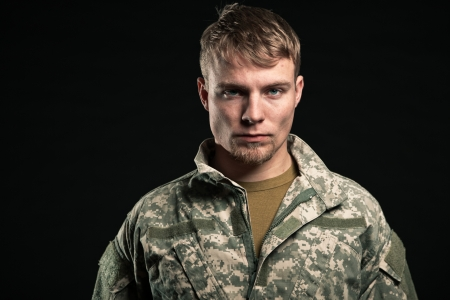fatigues: Military young man. Studio portrait. Stock Photo