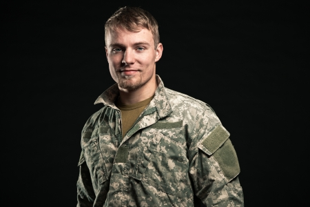 Military young man. Smiling. Studio portrait. photo