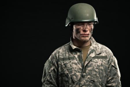 Military young man wearing helmet. Studio portrait. photo