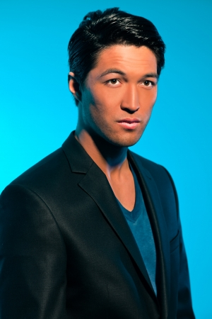 Handsome asian man in suit. Summer fashion. Studio shot. Stock Photo - 17802730