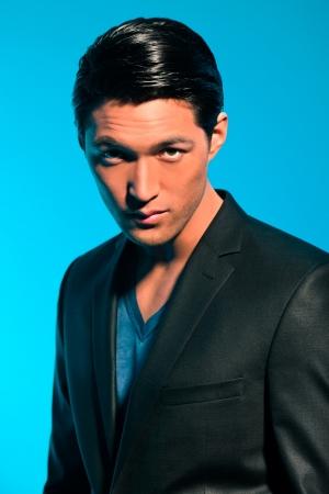 Handsome asian man in suit. Summer fashion. Studio shot. Stock Photo - 17802680