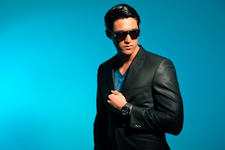 Asian man wearing suit and sunglasses. Summer fashion. Studio. photo