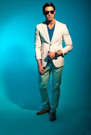 Asian man wearing suit and sunglasses. Summer fashion. Studio. Stock Photo - 17821496