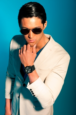 Asian man wearing suit and sunglasses. Summer fashion. Studio. Stock Photo - 17802807