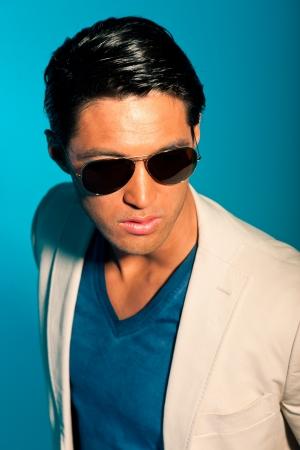 Asian man wearing suit and sunglasses. Summer fashion. Studio. Stock Photo - 17803086