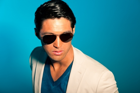 Asian man wearing suit and sunglasses. Summer fashion. Studio. Stock Photo - 17803105