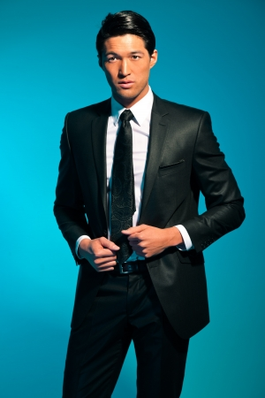 Handsome asian man in suit. Summer fashion. Studio shot. photo