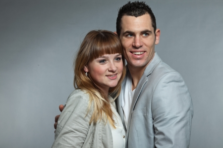 Young couple man and woman in love. Studio shot. photo