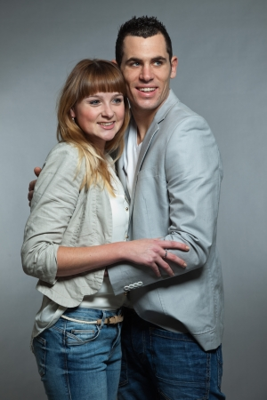 Young couple man and woman in love  Studio shot  photo