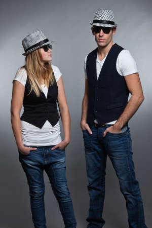 Young couple man and woman in love  Sunglasses and hat  photo