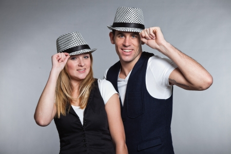 Happy young couple man and woman in love  Wearing hat  photo