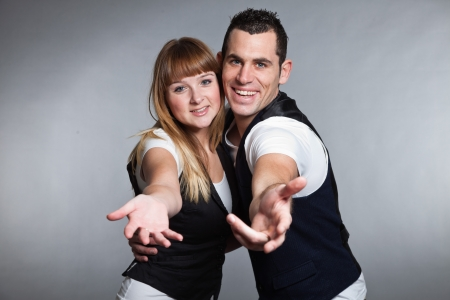 Beautiful young couple man and woman in love  Studio  photo