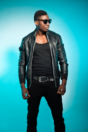 american sexy: Cool urban stylish black american man. Fashion studio shot.