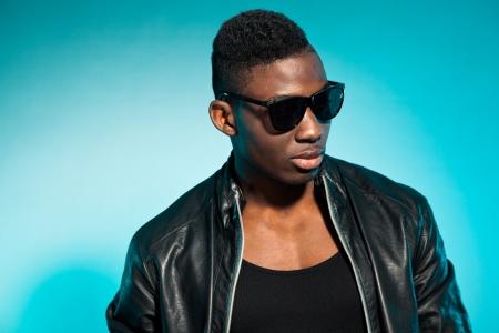 Cool urban stylish black american man. Fashion studio shot. Stock Photo - 17847985