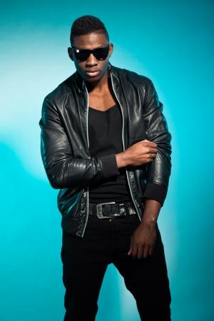 Cool urban stylish black american man. Fashion studio shot.