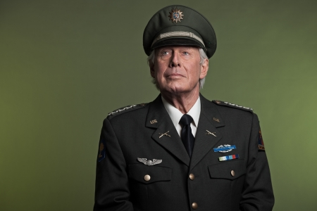 Military general in uniform. Studio portrait.