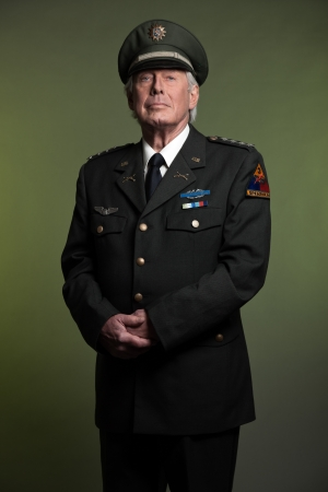 army boots: Military general in uniform. Studio portrait.