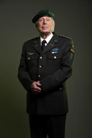 Military general in uniform wearing beret. Studio portrait. photo