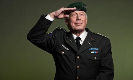 Military general wearing beret. Salutation. Studio portrait. photo