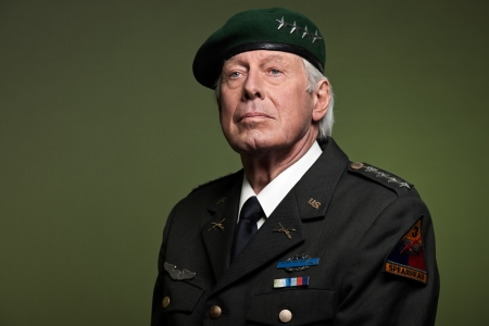 US military general wearing beret. Studio portrait. photo