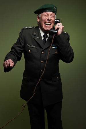 US military general wearing beret. Calling with phone. Studio portrait. photo