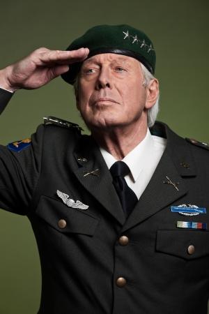 US military general wearing beret. Salutation. Studio portrait. photo