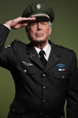 colonel: US military general wearing cap. Salutation. Studio portrait.