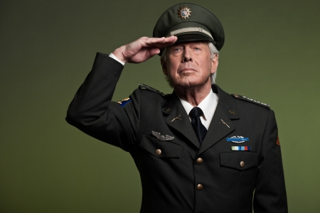 military uniform: US military general wearing cap. Salutation. Studio portrait.