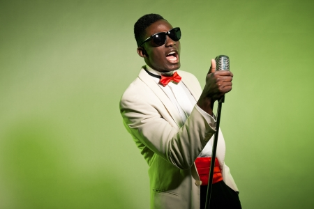 Singing black american man in suit wearing sunglasses. Vintage. Stock Photo