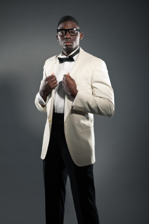 Stylish black american man in suit with glasses. Fashion studio shot. Stock Photo - 18162928
