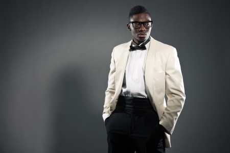 Stylish black american man in suit with glasses. Fashion studio shot. photo