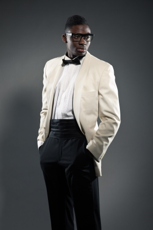 Stylish black american man in suit with glasses. Fashion studio shot. Stock Photo - 18162920