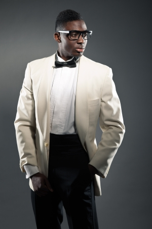 Stylish black american man in suit with glasses. Fashion studio shot. Stock Photo - 18183372