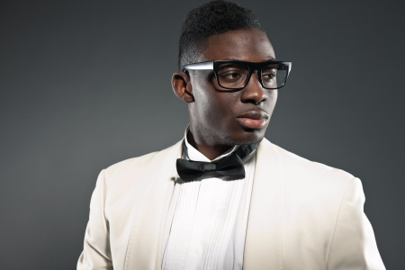 african american male: Stylish black american man in suit with glasses. Fashion studio shot.