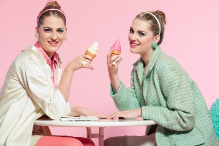 Two girls blonde hair fifties fashion style eating ice cream