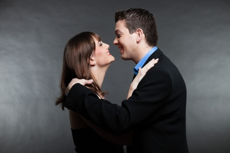 Romantic young couple in love. Man and woman. Studio shot.  photo