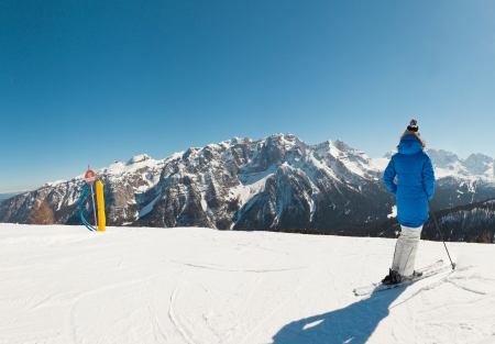 wintersport: Panorama of wintersport snow mountian landscape with ski woman. Stock Photo