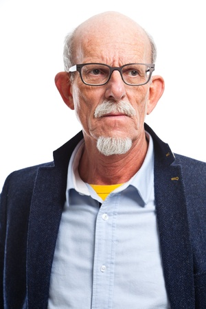 Serious well dressed senior man with glasses. Isolated. photo