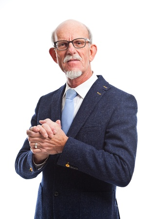 Smiling well dressed senior man with glasses. Isolated. photo