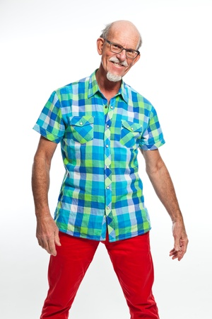 Funny well dressed senior man with glasses. Isolated. photo