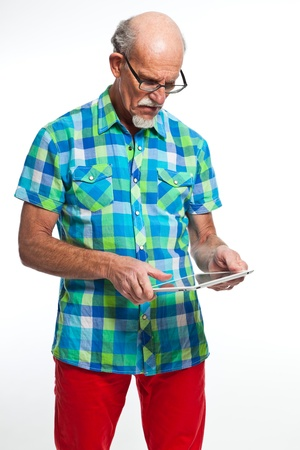 Well dressed senior man with tablet computer. Isolated. photo
