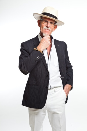 Well summer dressed senior man with hat. Isolated. photo